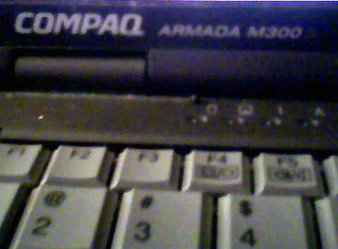 "Picture of a laptop showing its model of ""COMPAQ ARMADA M300"""