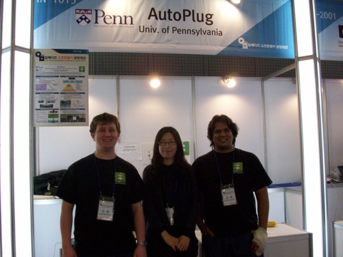 Picture of AutoPlug team in front of booth