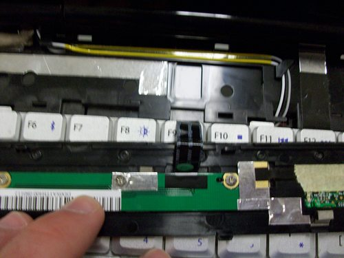 Picture of ribbon cable on bottom of plastic bar