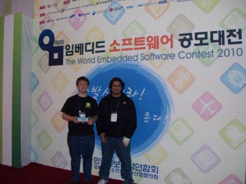 Madhur and I in front of a WESC wall holding the AutoPlug gateway