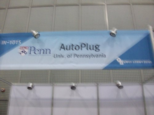 Picture of our sign above our booth for the competition