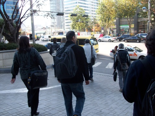 Picture of competitors walking to shuttle bus